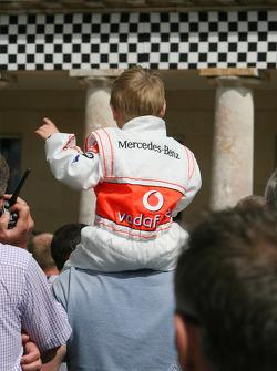 A young Lewis Hamilton fan