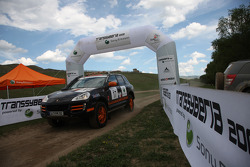 #17 Team France Porsche Cayenne S Transsyberia: Christian Lavieille and François Borsotto cross the finish line to win the Transsyberia Rally