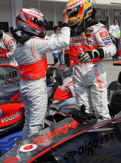 Heikki Kovalainen, McLaren Mercedes, 2nd and Lewis Hamilton, McLaren Mercedes, in pole position