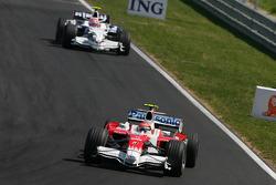Timo Glock, Toyota F1 Team, TF108 and Robert Kubica, BMW Sauber F1 Team, F1.08