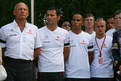 McLaren Mercedes drivers and team members during a minute silence in respect of the victims of the Madrid Plane crash