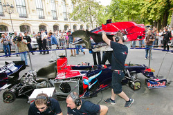 Scuderia Toro Rosso team members prepare the STR03 for the run