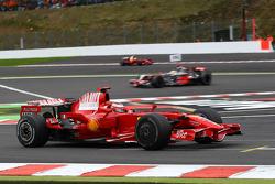 Kimi Raikkonen, Scuderia Ferrari, F2008 leads Lewis Hamilton, McLaren Mercedes, MP4-23 and Felipe Massa, Scuderia Ferrari, F2008