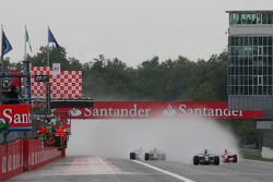 Start: Sebastian Vettel, Scuderia Toro Rosso, STR03 leads Heikki Kovalainen, McLaren Mercedes, MP4-23
