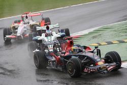 Sébastien Bourdais, Scuderia Toro Rosso, STR03 leads Jenson Button, Honda Racing F1 Team, RA108