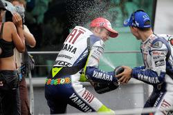 Podium: race winner Valentino Rossi celebrates with champagne