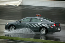 A safety car helps drying up the track