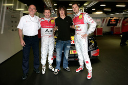 Dr Wolfgang Ullrich, Tom Kristensen and Martin Tomczyk with Carles Puyol, captain of FC Barcelona