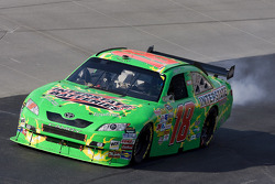 Kyle Busch pulls down on the apron as he has car trouble