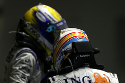 Race winner Fernando Alonso celebrates with Nico Rosberg