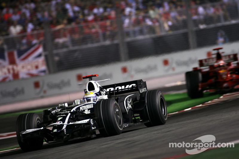 Nico Rosberg, Williams F1 Team; Kimi Raikkonen, Scuderia Ferrari