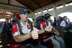 Daniel Sordo and Marc Marti ride a roller coaster