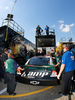 AMP Energy Chevy crew members brings a new car out of the hauler after the crash of Dale Earnhardt Jr.