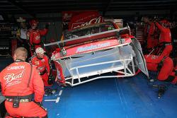 Budweiser Dodge crew member repair the car of Kasey Kahne