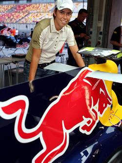 Golfer Eva Steinberger in the Red Bull Racing garage