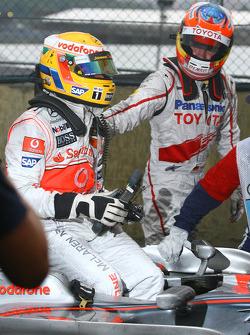 2008 World Champion Lewis Hamilton and Timo Glock