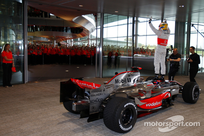 Lewis Hamilton arrives at the McLaren Technology Centre in the McLaren Mercedes MP4-23