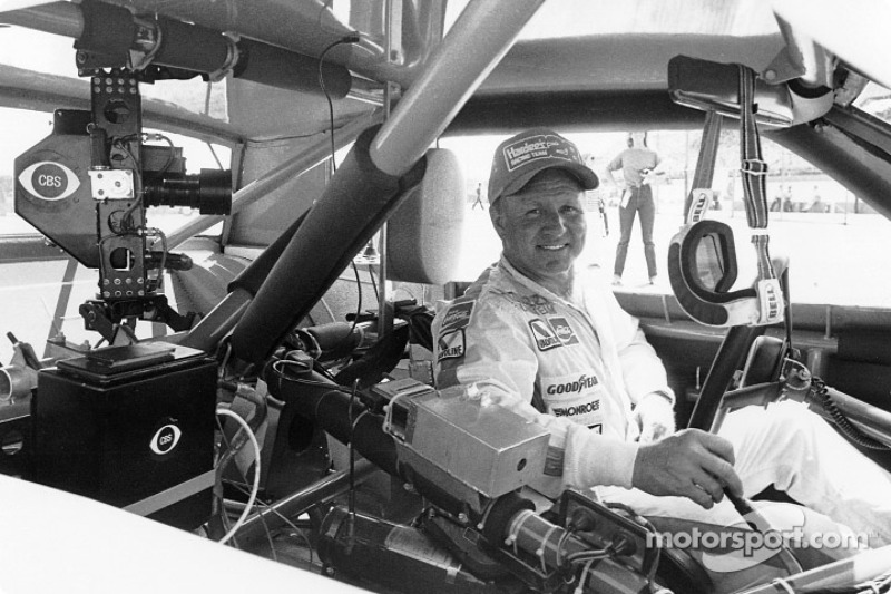 Cale Yarborough carries a CBS camera in his car for the second time and wins