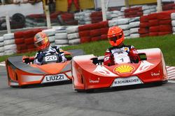 Michael Schumacher, Test Driver, Scuderia Ferrari and Vitantonio Liuzzi, Test Driver, Force India F1 Team