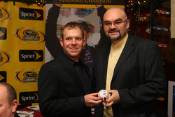 NASCAR Sprint Cup Series Raybestos Rookie of the Year Regan Smith signs a baseball for Foley's owner Shaun Clancy