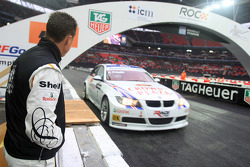 Michael Schumacher watches Andy Priaulx demonstrate his BMW World Touring Car for the crowd