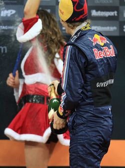 Podium: Sebastian Vettel sprays champagne