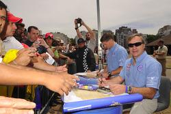 Michel Périn and Carlos Sainz sign autographs