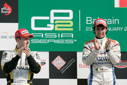 Sergio Perez celebrates his victory on the podium with Davide Valsecchi