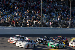 Brian Scott and Michael Annett lead a group of cars