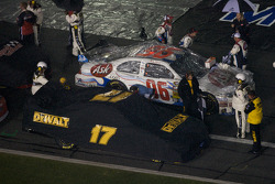 Cars of Matt Kenseth, Roush Fenway Racing Ford and Bobby Labonte, Hall of Fame Racing Ford are covered as the rain falls