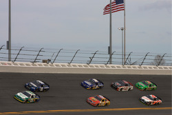 Clint Bowyer and Tony Stewart lead a group of cars