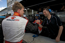 GT2 pole winner Dirk Werner celebrates