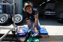 Alex Zanardi, BMW Team Italy-Spain cleaning his helmets