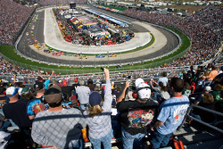 Fans cheer as the field makes the first lap