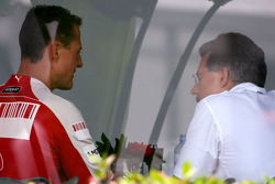 Michael Schumacher, Test Driver, Scuderia Ferrari goes to the BMW Sauber F1 Team office with Dr. Mario Theissen, BMW Sauber F1 Team, BMW Motorsport Director