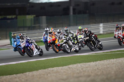 Chris Vermeulen, Rizla Suzuki MotoGP, Jorge Lorenzo, Fiat Yamaha Team, Andrea Dovizioso, Repsol Honda Team, Randy De Puniet, LCR Honda MotoGP, battle at the start