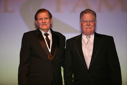 NASCAR Sprint Cup Series championship-winning car owner Bud Moore poses with his presenter, NASCAR Hall of Fame Historian Buz McKim, at the International Motorsports Hall of Fame induction ceremony