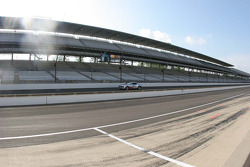 The Camaro pace car practices before the massive grandstands
