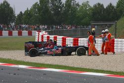 Sebastien Buemi, Scuderia Toro Rosso after crashing