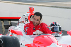 Helio Castroneves, Team Penske tries to keep his ears warm during the front row photo shoot