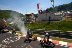 Drivers parade around the track: a stunt bike show at Breidscheid