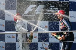 Podium: race winner Jenson Button, Brawn GP with second place Mark Webber