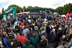 A massive crowd as Team Peugeot Total Peugeot 908 cars arrive at scrutineering