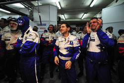 Peugeot team members celebrate Stéphane Sarrazin's pole position
