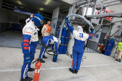 Team Peugeot Total team members after a pit stop