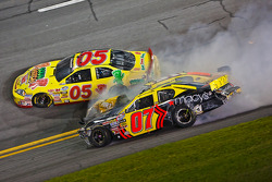 Jeff Green and Chase Austin tangle up off of turn 4