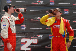 Podium: race winner Sebastian Saavedra, second place J.R. Hildebrand