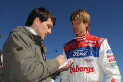 Marcus Gronholm talks to a journalist after Thursday practice at Pikes Peak International Hillclimb