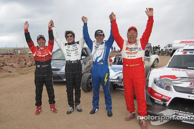 Nobuhiro Tajima celebrates with the team