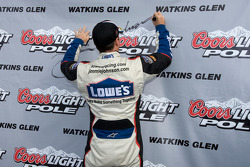 Pole winner Jimmie Johnson, Hendrick Motorsports Chevrolet, signs his name on the pole award board
